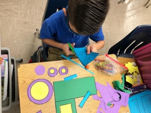 1st grade students working on their small motor skills when working on their ten frame skills